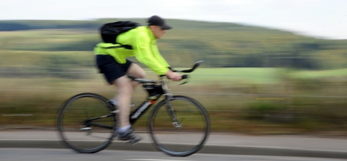 Blurred image of a cyclist